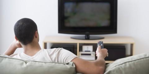USA, New Jersey, Jersey City, Man watching tv at home