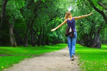 bigstock-Young-woman-walking-on-path-in-14019392